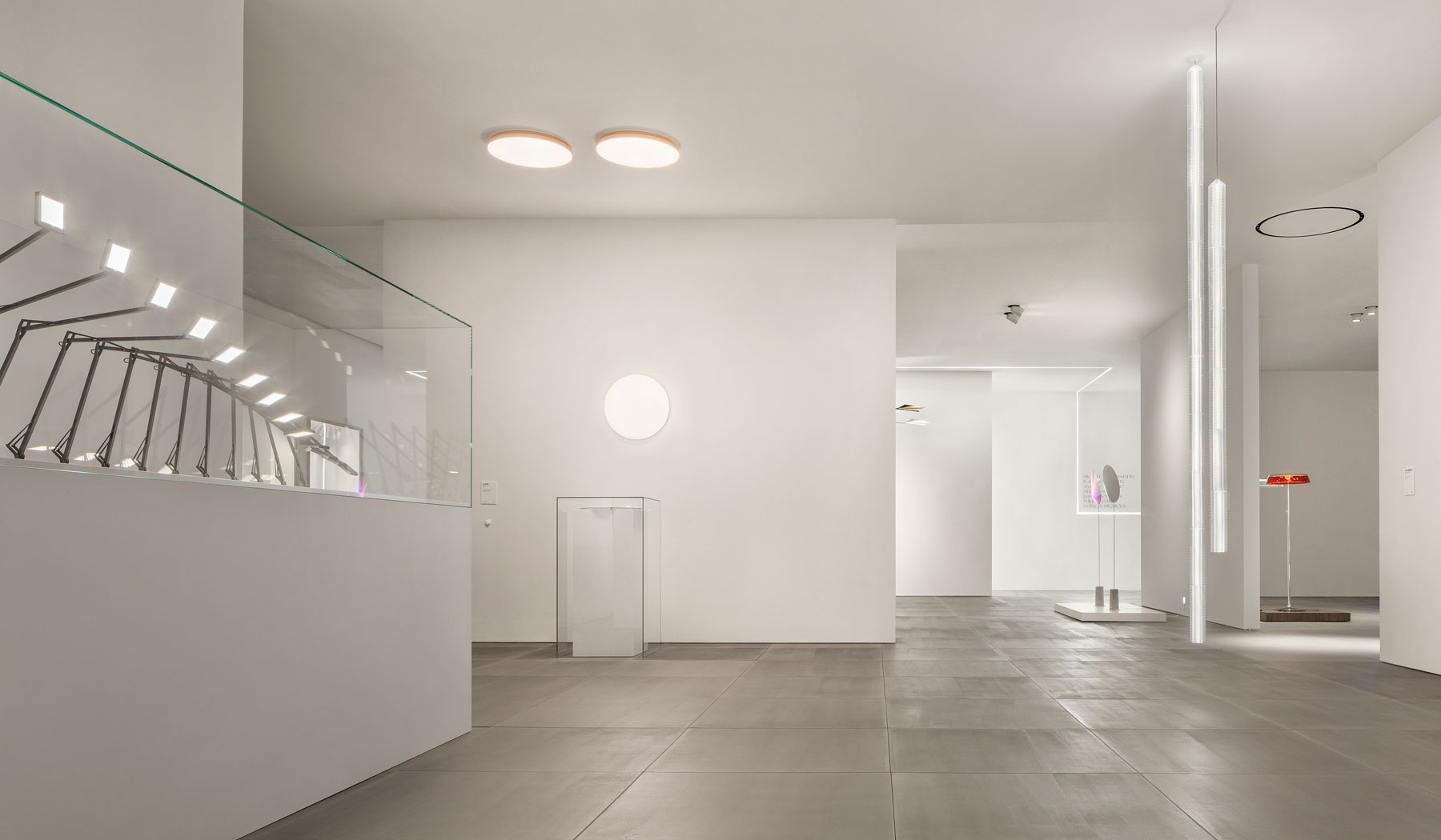 FLOS booth with Clara LED wall ceiling light fixture